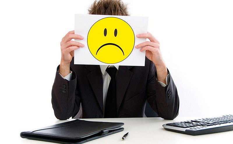 Man holding sad smiley